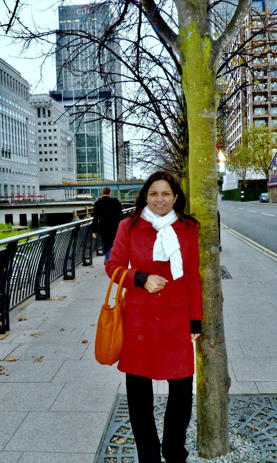 europe winter travel outfit ideas europe,winter,travel,outfit,ideas.styleguide,winter vacation, red coat, faux fur coat,